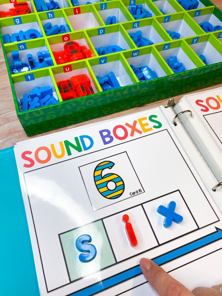 sound box being used as a tools to stretch out CVC words in a literacy intervention lesson